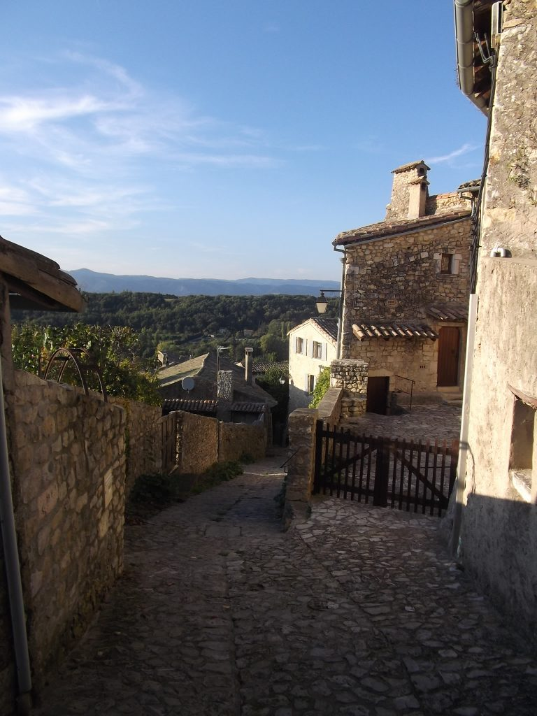 Looking down the cobbled streets of Mirmande towards the Ardeche hills on the other side of the Rhone.